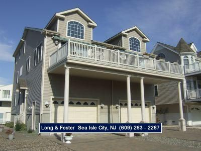 Photo for Views of wetlands and sunsets from large front deck. Great location close to restaurants and shopping.