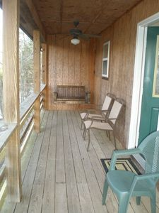 Porch off of kitchen that faces lake.