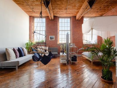 Photo for Bright, Creative Loft on the River Near Downtown