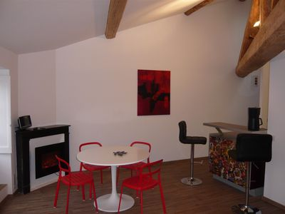Dining area with an electric fireplace