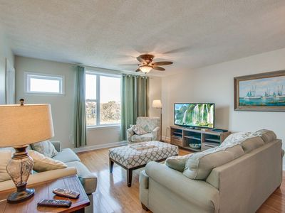 Photo for Second-floor condo with river views and access to a community pool
