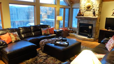 Main Floor Family Room with ample seating, fireplace, TV, DVD player, games, etc