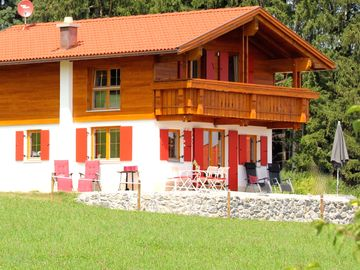 Large holiday home with open lake and alp views, boat and many other extras