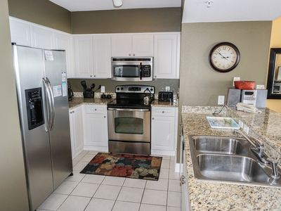 Stocked kitchen with upgraded stainless appliances