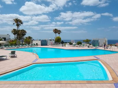Photo for LOMA VERDE AIRCON POOLSIDE HOME - Puerto del Carmen Old Town - Gated/Parking
