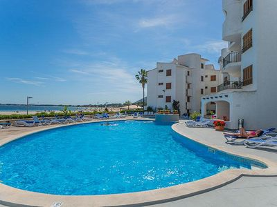 Photo for Living right on the beach, relaxing and sunbathing in the large pool area