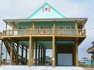 Photo for At Water's Edge - Beautifully decorated beachfront in popular Holiday Beach!