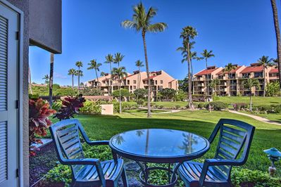 Towering palm trees, a sparkling pool and a sea breeze await at this cozy condo!