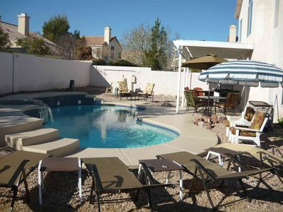 Photo for Quality, Four Bedroom, Oasis Pool and Hot Tub Home-