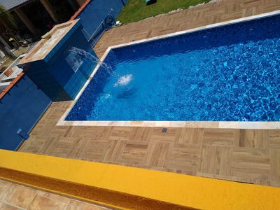 Photo for Carnival available * with pool, barbecue and games room in condominium.