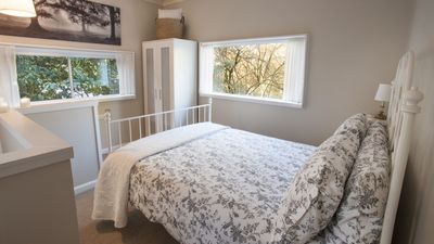 The Dovecote bedroom has windows on 3 sides looking over the treetops.