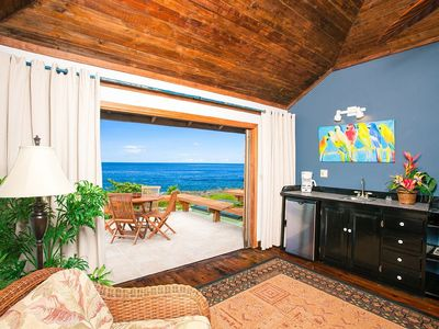 Sitting room with wet bar opens up to private deck and views