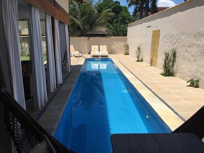 Photo for Beautiful house with pool and 8 suites, facing the river, for up to 27 people