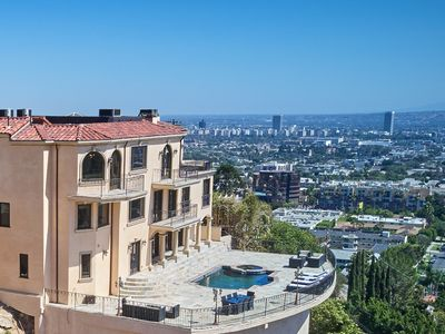 Photo for Luxury Gated Hollywood Hills View Estate with heated pool. Sleeps 1 To 14.