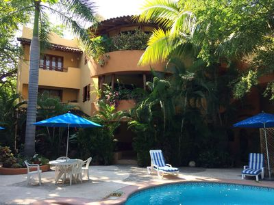 Photo for Luxurious Pool Side Condo, Ground Level.  Close to Beach & Town Center