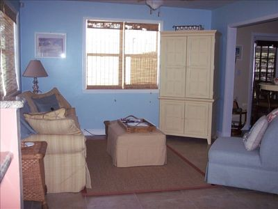 Living Rm: Sofa has Queen Pullout (extra), HDTV & DVD in Hutch & Ceiling Fan.