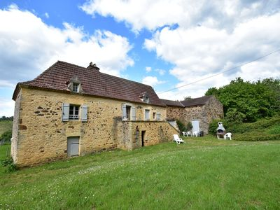 Photo for Beautiful holiday home in wooded grounds near Villefranche-du-Périgord (7 km)