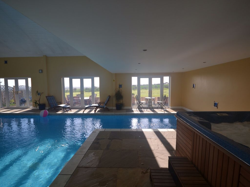 Indoor pool and hot tub with a slide  The Barn, Catley Hill: Luxury barn with heated indoor pool & hot ...