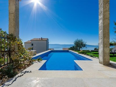 Photo for Holiday apartment with stunning sea views, air conditioning, Internet, satellite TV and barbecue