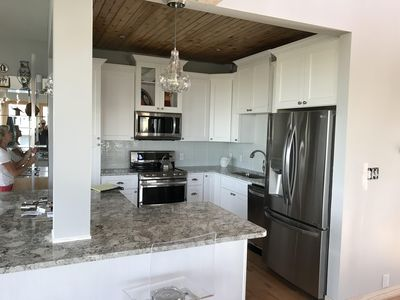 Kitchen with all new appliances, cabinets, and granite countertops