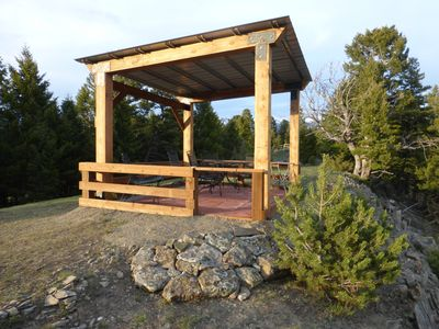 Hilltop gazebo overlooks four mountain ranges.