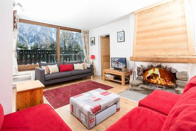 Large lounge with comfy sofa and log fire