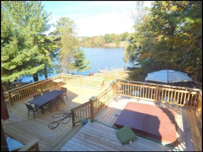 Photo for LakeFront, Large Windows, Decks, Hot Tub, Sauna, Games and more.