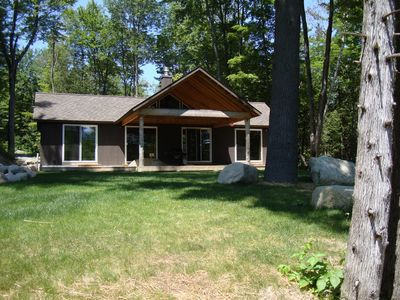 Large boulders to sit or climb on in front of the covered deck.
