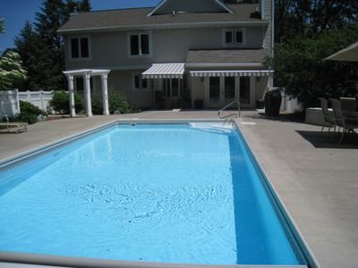 Photo for Celebration House Sleeps 12  4 Bedroom 2 1/2 Bath Private Beach In-Ground pool