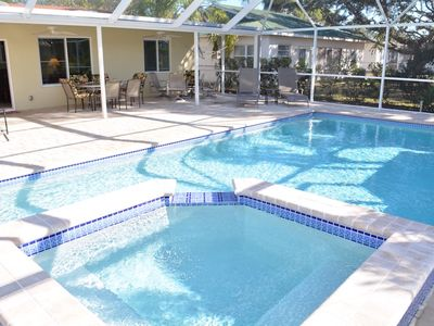 Photo for REMODELED POOL HOME, 1 MILE FROM THE BEACH, 3 BED 2 BATH, HEATED POOL AND SPA