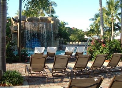 Waterfall pool  Poolside servers will be by with your favorite drink !!