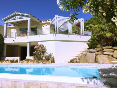 Photo for New listing! Gorgeous villa with infinity pool, fantastic sea views and air-con.
