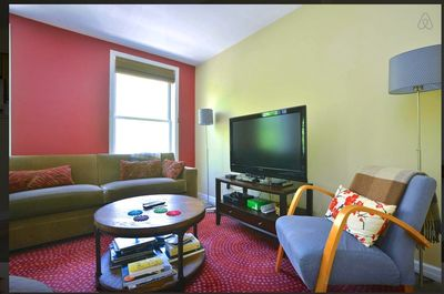"CU of living area: 42"" Philips LCD TV, Apple TV & Wii Kinect Blu-ray player."