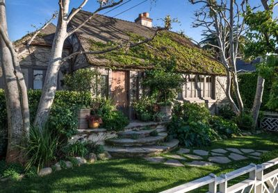 Front View of the Charming Tudor Cottage reminiscent of aThomas Kinkade painting