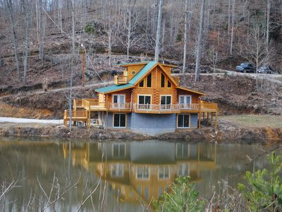 Photo for New, 3 floor cabin with large rec room with hot tub, beside 7 acre lake!