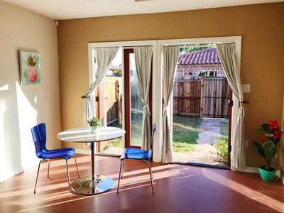 Dining space for two looking out to private backyard.