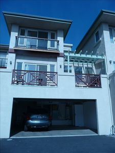 Back View of Condo with Double Garage