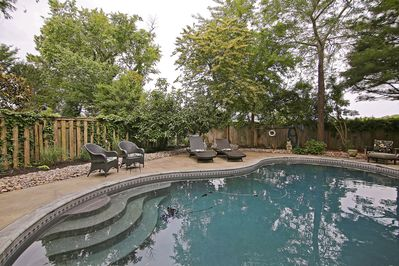 Beautifully Landscaped backyard Oasis with Large in-ground pool.