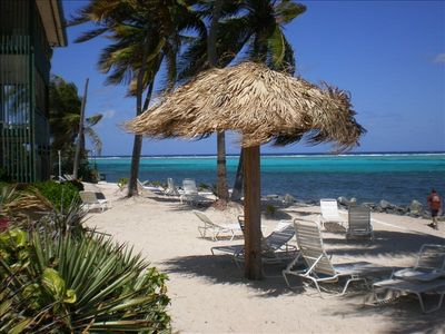 Welcome to Paradise: chaise lounges and shade for your enjoyment on the beach.
