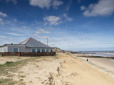Photo for Wyndham Beach House is a modern bungalow  which sits at the top of the beach