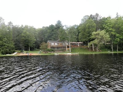 SECLUDED LODGE WITH ONE OF THE LARGEST PRIVATE STOCKED LAKES IN MICHIGAN