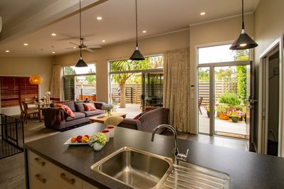 Open plan living,  indoor outdoor flow onto the large private deck, with spa pool. Ceiling fan for summer cooling.