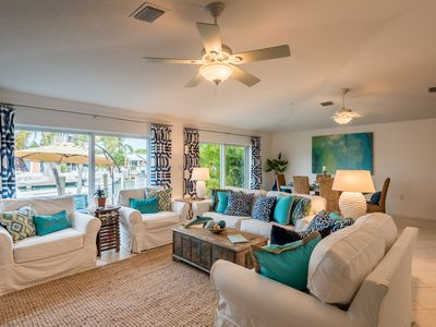 Photo for Professionally Decorated, 5-Star Canal Front Beach House with Private Dock!