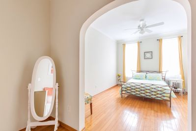 Master bedroom with beautiful architecture, heat, fan, AC, etc. View from den.