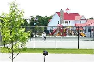 Tennis courts, swimming pools, playground & exercise facility across street.