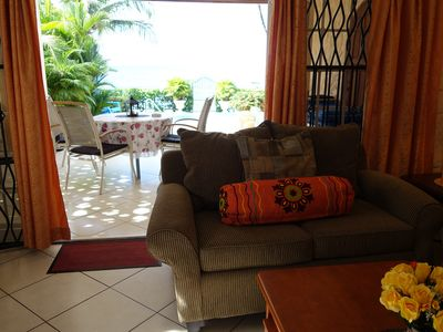 Photo for Hummingbird Beachfront Apt - Direct beach access, stunning view to the sunsets