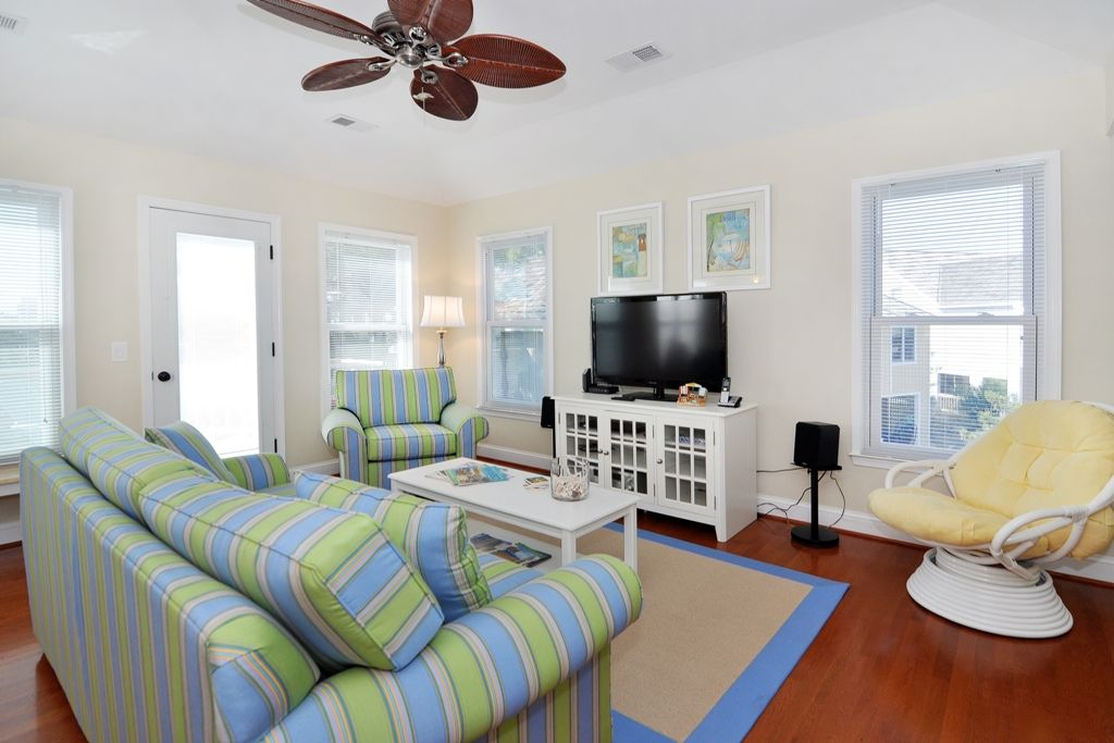 On The Sunny Side: Soundside golf villa offers access to oceanfront beach club with community pool.