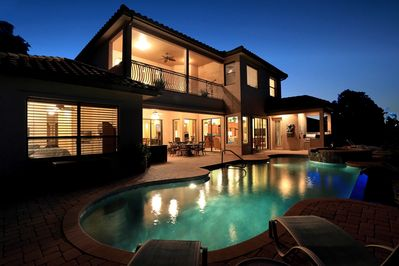 Night view with infinity pool/spa