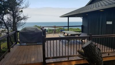 main deck with  bbq, picnic table,