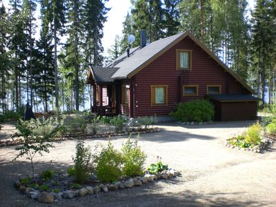 Photo for Cozy new 5 star log cabin right on the lake. Finland. Water and forest